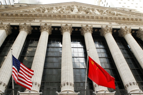 The flags of the United States and China hang outside of the New York Stock Exchange