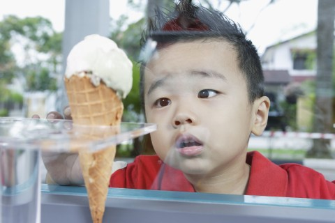 Boy looking at ice cream