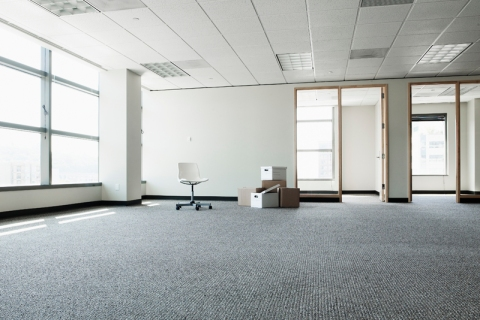 Empty office with boxes and one chair