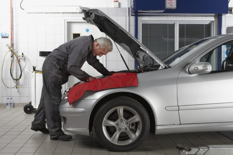 Mechanic working on car at auto repair shop
