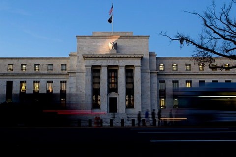 Image: Vehicles pass the U.S. Federal Reserve building in Washington, D.C.