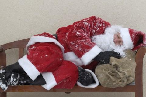 Santa Claus asleep on bench