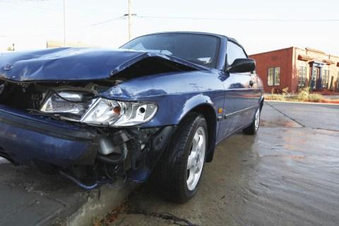 Damaged car on curb