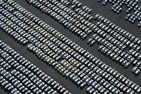 Rows of new cars at dealership