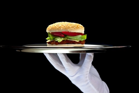 White Gloved Hand Holding Platter with Hamburger