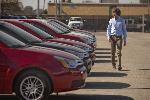 man walking new car lot