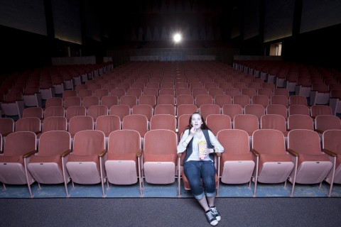 Woman in movie theater