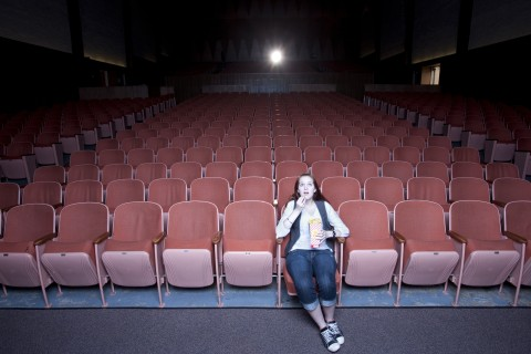 woman in empty movie theater