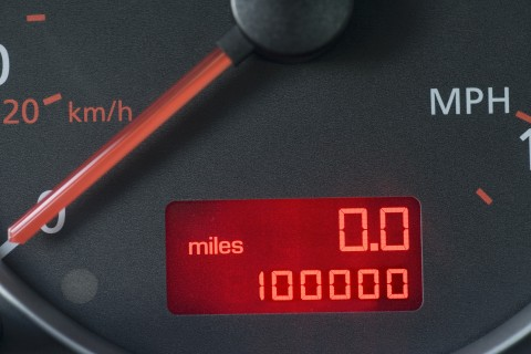 Close-up of odometer reading 100,000