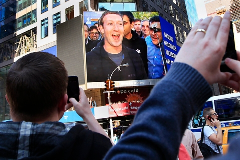 Facebook Inc. CEO Mark Zuckerberg is seen on a screen televised from their headquarters in Menlo Park moments after their IPO launch in New York