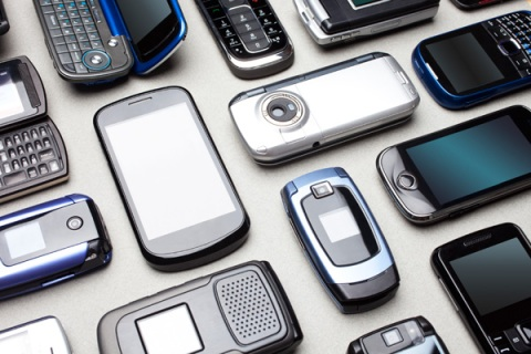 Multiple cell phones on table