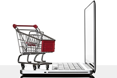 Shopping cart and laptop computer still life