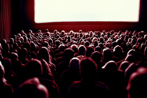 Crowd watching movie in theater
