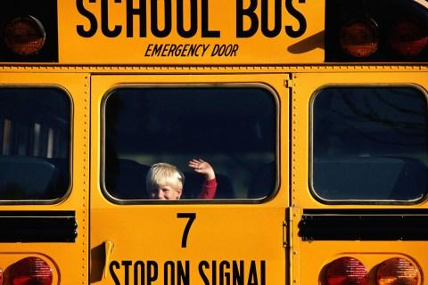 young boy in school bus