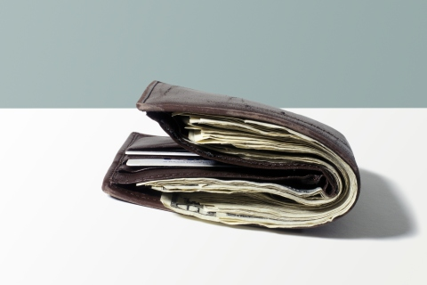 Bulging wallet filled with money