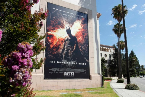 """A poster for the Warner Bros. film """"The Dark Knight Rises"""" is displayed in Burbank"""