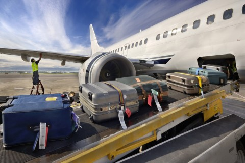 checked baggage loading onto airplane