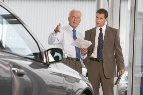 Car salesman at dealership