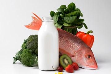 Bottle of milk, fish, fruits and vegetables.