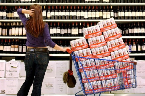 woman buying beer and wine