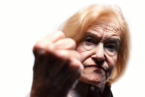 Senior citizen raising fist in anger