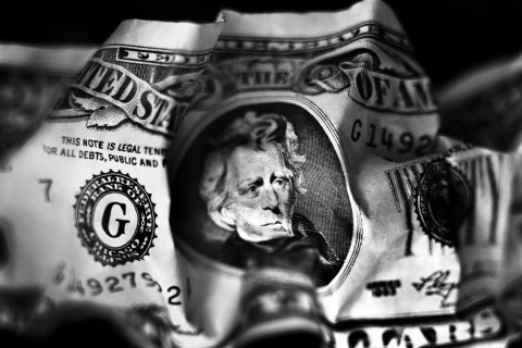Crumpled twenty-dollar bill