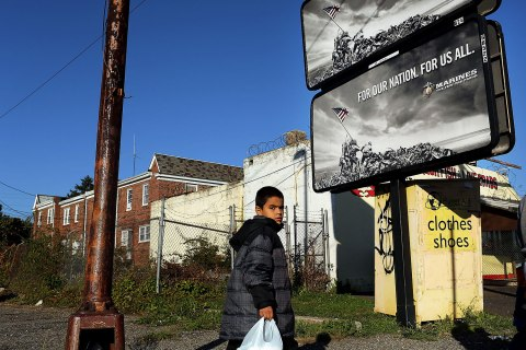 image: A child walks down a street in Camden, N.J., on October 11, 2012.