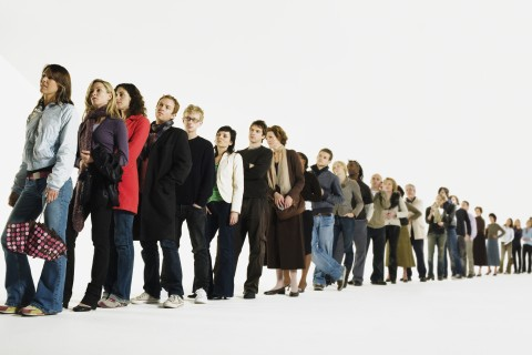 Row of people standing in line