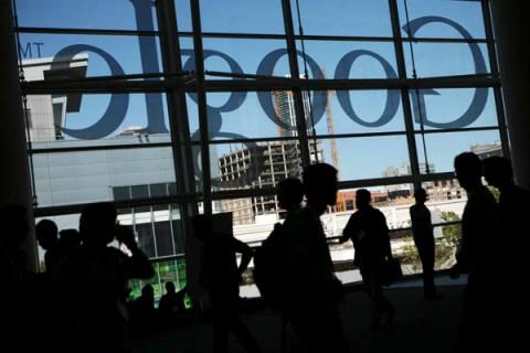 A Google logo is seen through windows of
