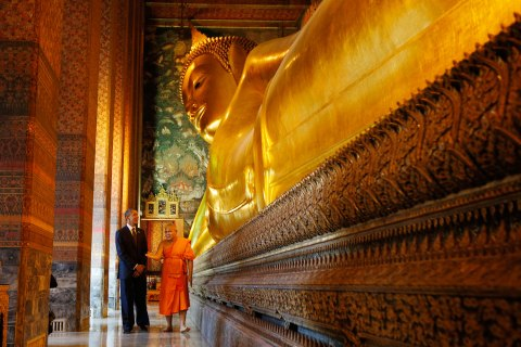 U.S. President Barack Obama tours the Reclining Buddha in Thailand