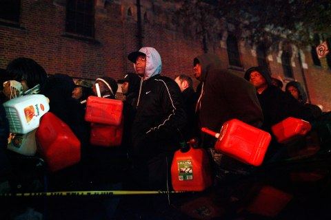 image: Crowds wait for free gas at the Bedford Avenue Armory in the Brooklyn, N.Y., Nov. 3, 2012.