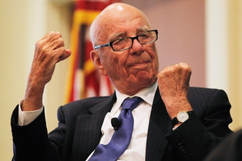 "News Corp Chairman and CEO Rupert Murdoch gestures as he speaks at the ""The Economics and Politics of Immigration"" Forum in Boston"