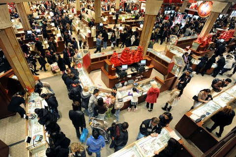 "People crowd the aisles inside Macy's department store November 25, 2011 in New York after the midnight opening to begin the ""Black Friday"" shopping weekend."