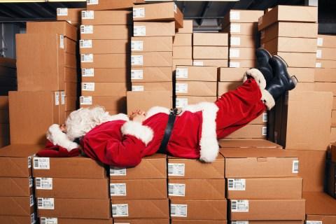 Santa sleeping on boxes