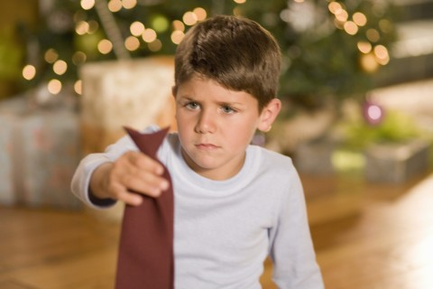 Boy disappointed with Christmas gift