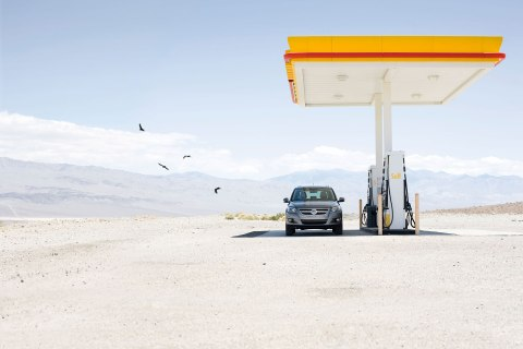 image: Car At Gas Station In Desert