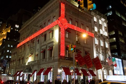 image: A general view of the exterior of the Cartier store wrapped with red ribbon in New York City, Dec. 12, 2012.
