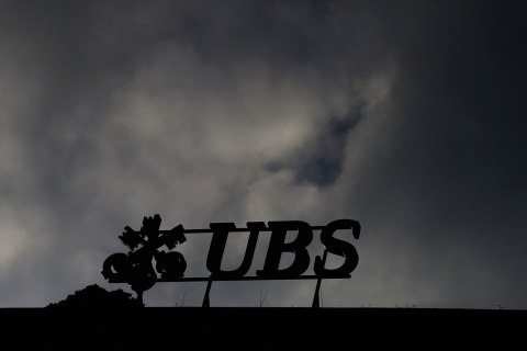 image: The logo of Swiss bank UBS is seen on a building in Zurich, Dec. 19, 2012.