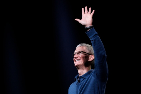 Apple CEO Tim Cook waves to the audience during an Apple event in San Jose