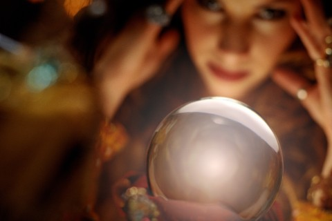 fortune teller looking at crystal ball