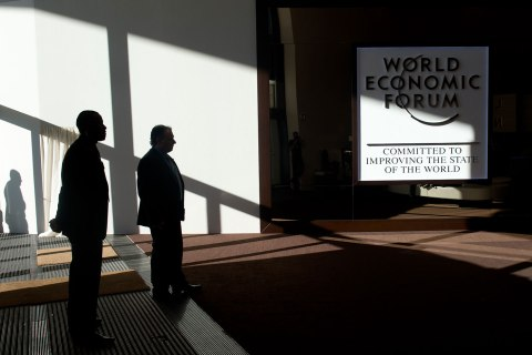 People stand in the Swiss resort at the World Economic Forum Annual Meeting 2013 in Davos, Jan. 26, 2013.