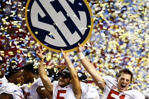 image: Alabama Crimson Tidekicker Jeremy Shelley, center, and long snapper Carson Tinker, right, celebrate after beating the Georgia Bulldogs during the NCAA SEC college football championship in Atlanta, Dec. 1, 2012.