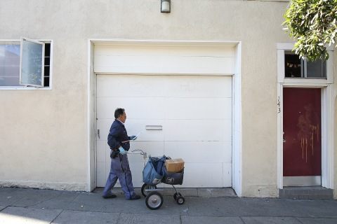 A U.S. post office delivery man on Dec. 5, 2011 in San Francisco, Calif.