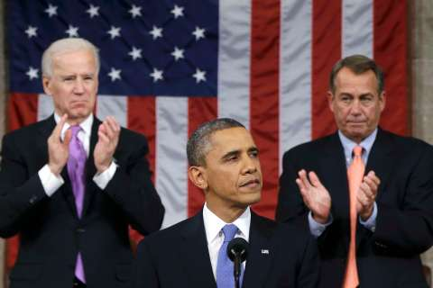 U.S. House Speaker John Boehner and Vice President Joe Biden stand to applaud as President Barack Obama delivers his State of the Union speech on Capitol Hill in Washington, Feb. 12, 2013.