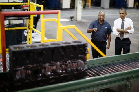 President Barack Obama is shown a truck engine block being manufactured as he tours Linamar Corporation in Arden, N.C, Feb. 13, 2013.