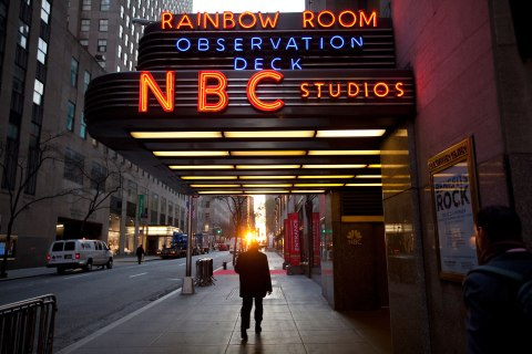 A pedestrian walks in front of NBC Studios on 50th Street in New York City, Dec. 1, 2009.