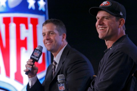 San Francisco 49ers head coach Jim and his brother, Baltimore Ravens head coach John Harbaugh, appear during their joint press conference ahead of the NFL's Super Bowl XLVII in New Orleans