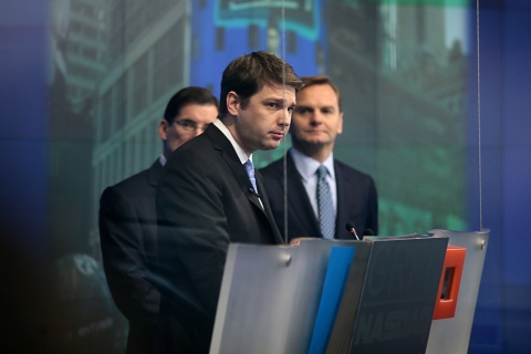 Andrew Mason, chief executive officer of Groupon Inc., center, speaks at the Nasdaq MarketSite in New York on Nov. 4, 2011.