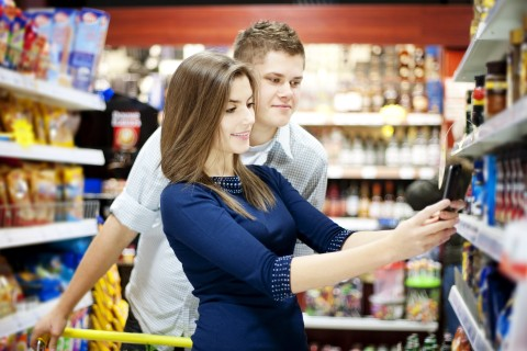 Young couple shopping at supermarket