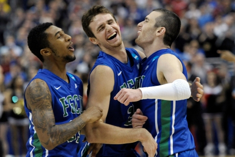 Florida Gulf Coast's Dajuan Graf, from left, Eddie Murray and Brett Comer celebrate after winning a third-round game against San Diego State in the NCAA college basketball tournament, on March 24, 2013, in Philadelphia. Fla.